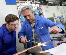 41252053 - teacher with student in metallurgy workshop