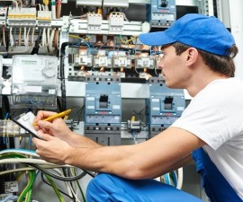 21716818 - young adult electrician builder engineer inspecting electric counter equipment in distribution fuse box